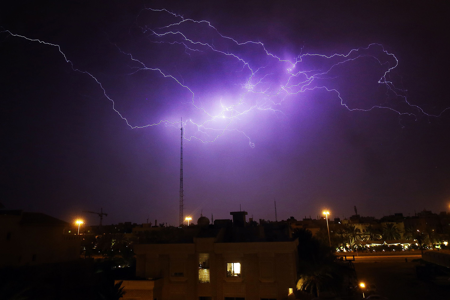 Lightning flashes in the sky over the district of Rumaithiya in Kuwait City during a storm April 7. YASSER AL-ZAYYAT/AFP via Getty Images
