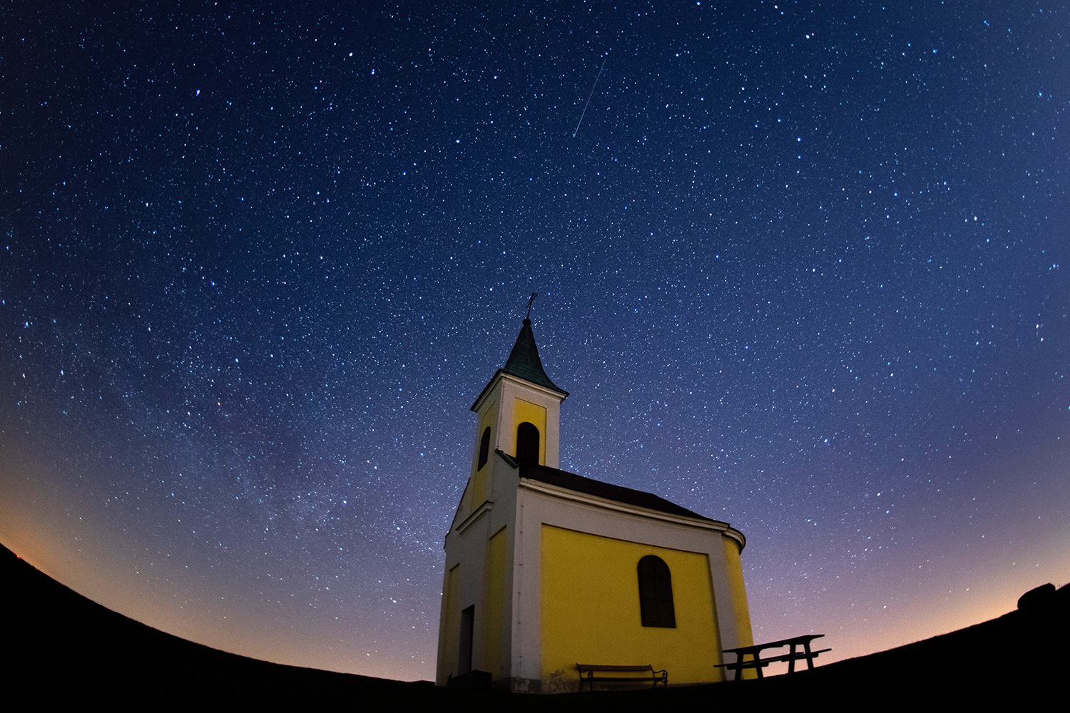 The Lyrids meteor shower streaks across the sky over Michaelskapelle in Niederhollabrunn, Austria, on April 21. Thomas Kronsteiner/Getty Images