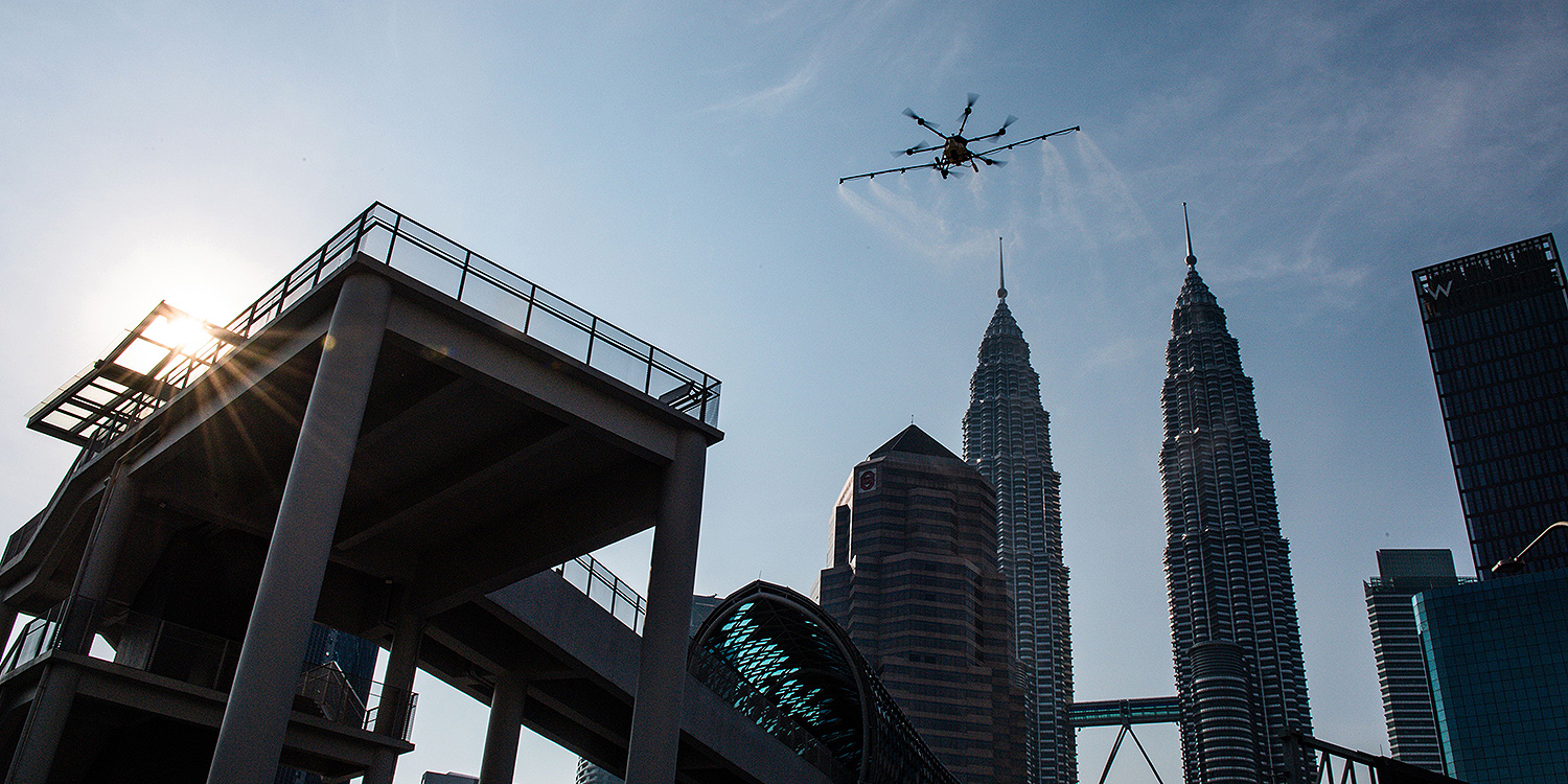 Against the backdrop of the Petronas Twin Towers, a drone sprays disinfectant in Kuala Lumpur, Malaysia, as a preventive measure against the spread of the coronavirus March 31. Petronas has accounted for 15 percent of Malaysia's total revenue over the past five years.