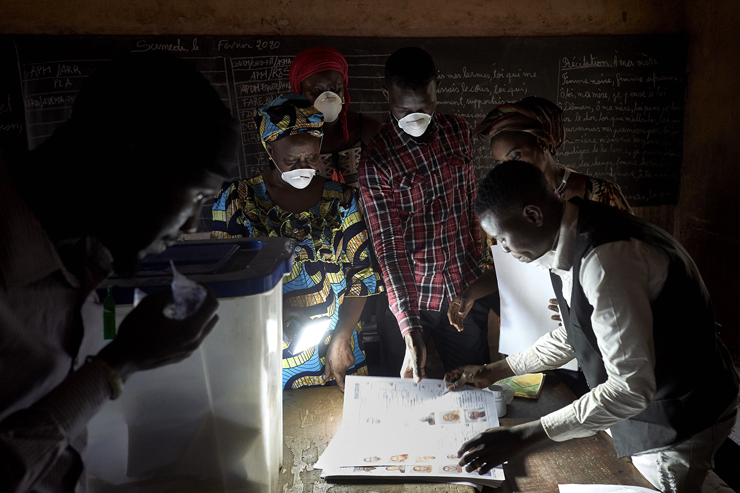 Election officials count votes at a polling station in Bamako, Mali, on March 29. The long-delayed parliamentary election in war-torn Mali was held just hours after the country recorded its first COVID-19 death. MICHELE CATTANI/AFP via Getty Images