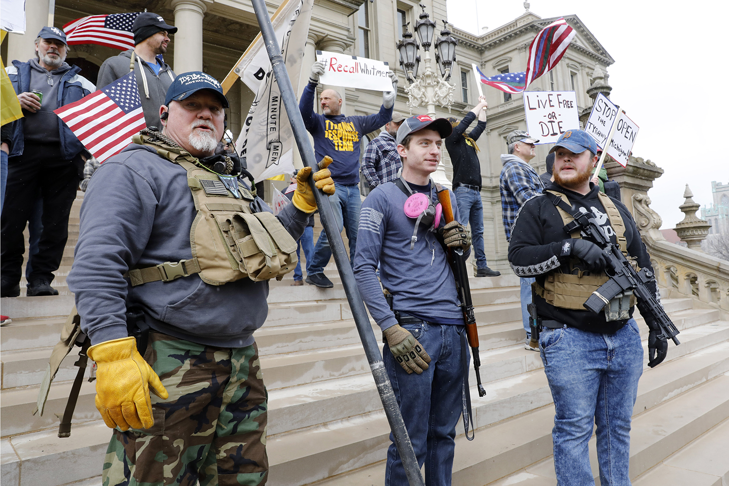 People take part in a protest for Michiganders Against Excessive Quarantine at the Michigan State Capitol in Lansing on April 15. JEFF KOWALSKY/AFP via Getty Images
