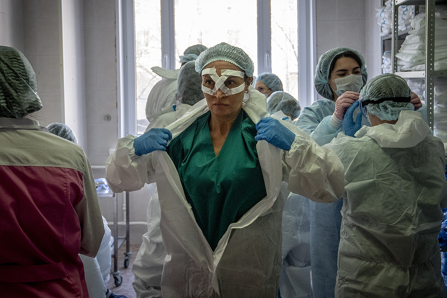 Medical workers get ready for their shift treating coronavirus patients at the Spasokukotsky clinical hospital in Moscow on April 22. YURI KADOBNOV/AFP via Getty Images