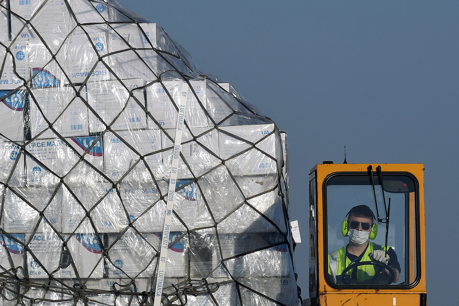 A batch of 8 million protective masks arrives from Shanghai and is unloaded from a Lufthansa plane at the airport in Munich on April 7. CHRISTOF STACHE/AFP via Getty Images