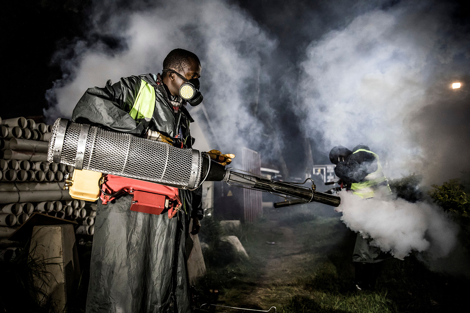 A member of a privately funded nongovernmental organization fumigates and disinfects the streets and the stalls at Parklands City Park Market in Nairobi, Kenya, to help curb the spread of the coronavirus April 15. LUIS TATO/AFP via Getty Images