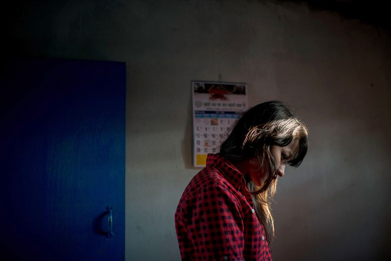 A young woman believed to be a victim of human trafficking is questioned by police in Kathmandu, Nepal