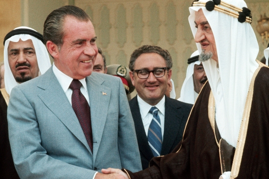 U.S. President Richard Nixon and national security adviser Henry Kissinger visit with Saudi King Faisal in Saudi Arabia on June 14, 1974. Nixon spoke with Faisal about the global impact of the oil embargo.