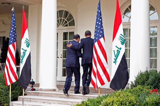 Iraqi Prime Minister Nouri al-Maliki and U.S. President Barack Obama leave the Rose Garden after a press conference at the White House on July 22, 2009.