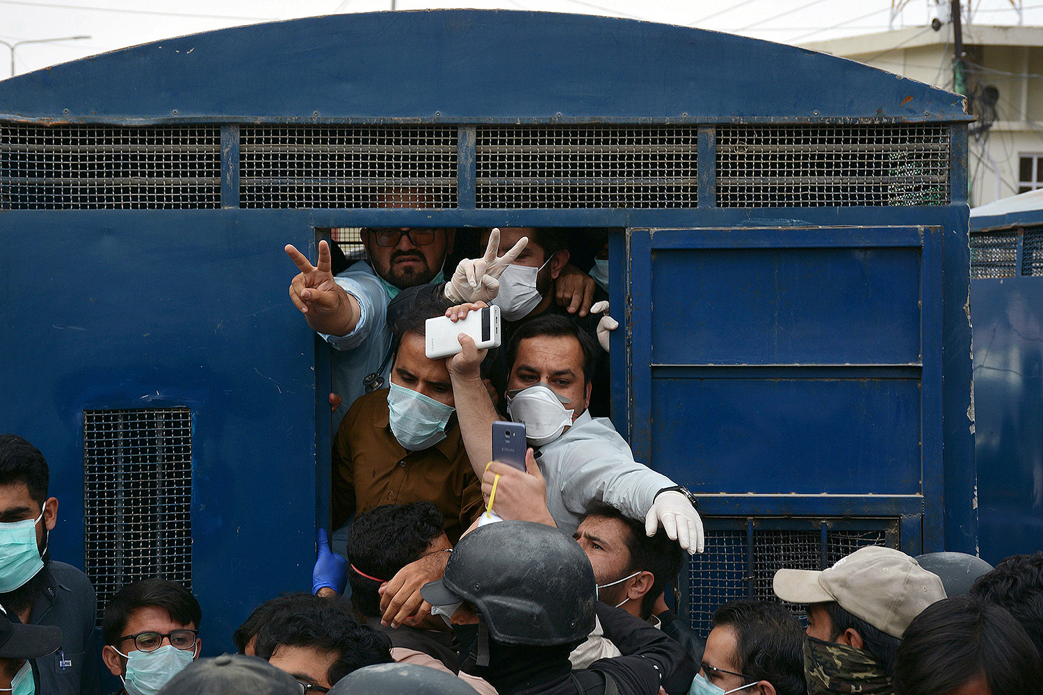Authorities in Pakistan's southwestern city of Quetta arrest dozens of doctors and paramedics who were protesting against the lack of safety equipment April 6. BANARAS KHAN/AFP via Getty Images