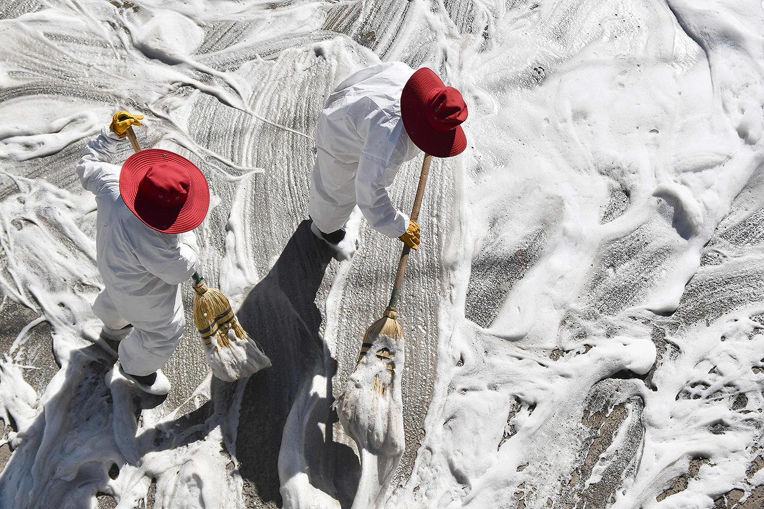 Municipal workers in Arequipa, the second-largest city in Peru, scrub the streets surrounding a market on April 15—a sanitary measure to fight the spread of the coronavirus. DIEGO RAMOS/AFP via Getty Images