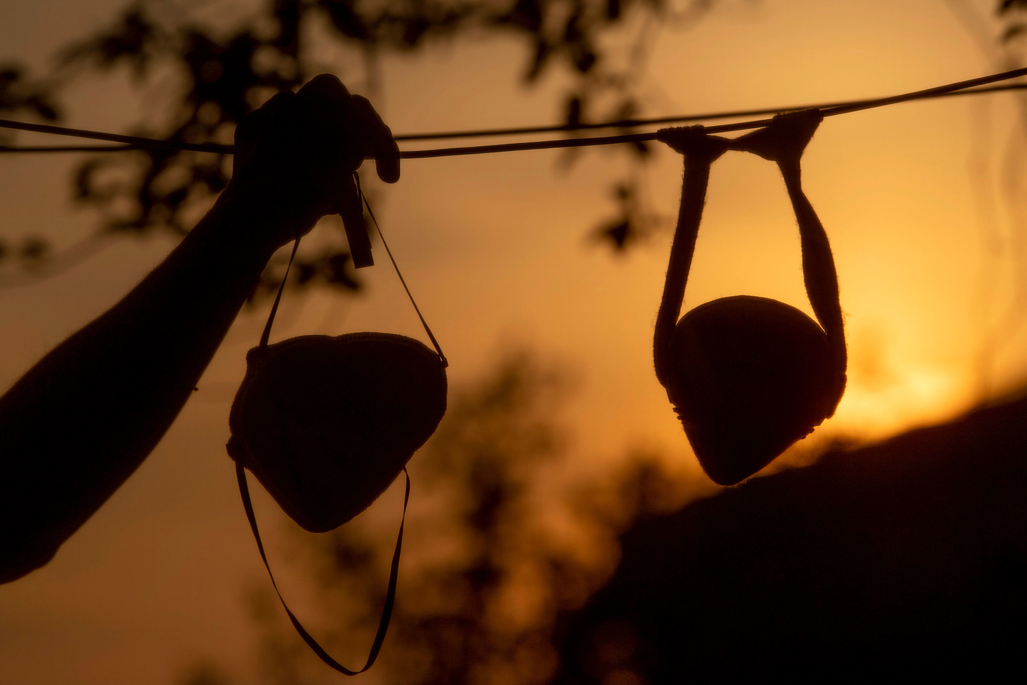 A resident hangs face masks up to dry on a clothesline in Rome on April 13. TIZIANA FABI/AFP via Getty Images