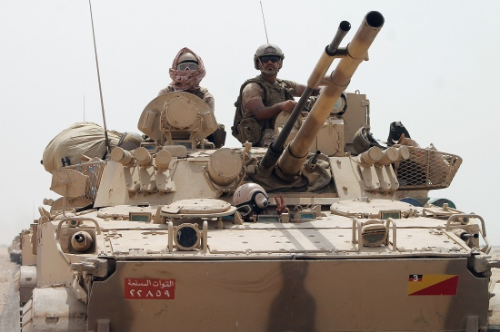 Saudi-led coalition soldiers deploy to the outskirts of Aden, Yemen, on Aug. 3, 2015, during a military operation against Houthi rebels and their allies.