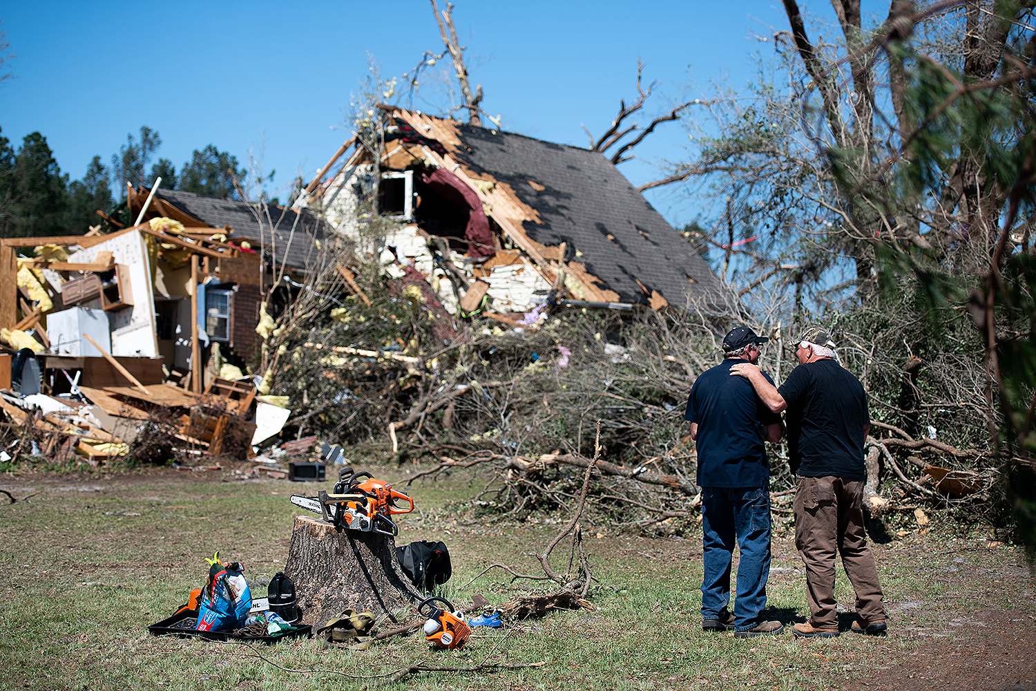 Two men talk April 13 in front of a home near Nixville, South Carolina, that was destroyed by a tornado. A string of storms across the southern United States began Easter Sunday and continued into the workweek. Sean Rayford/Getty Images