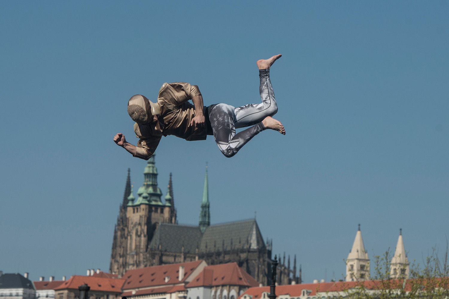 A street artist soars through the air after jumping off a trampoline in Prague on April 9. MICHAL CIZEK/AFP via Getty Images