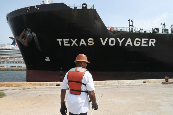A line handler helps dock the oil tanker Texas Voyager as it pulls into its mooring at Port Everglades in Fort Lauderdale, Florida, on April 21. The day before, the price of West Texas Intermediate oil futures for delivery in May fell into negative territory—minus .63 a barrel—for the first time in history.