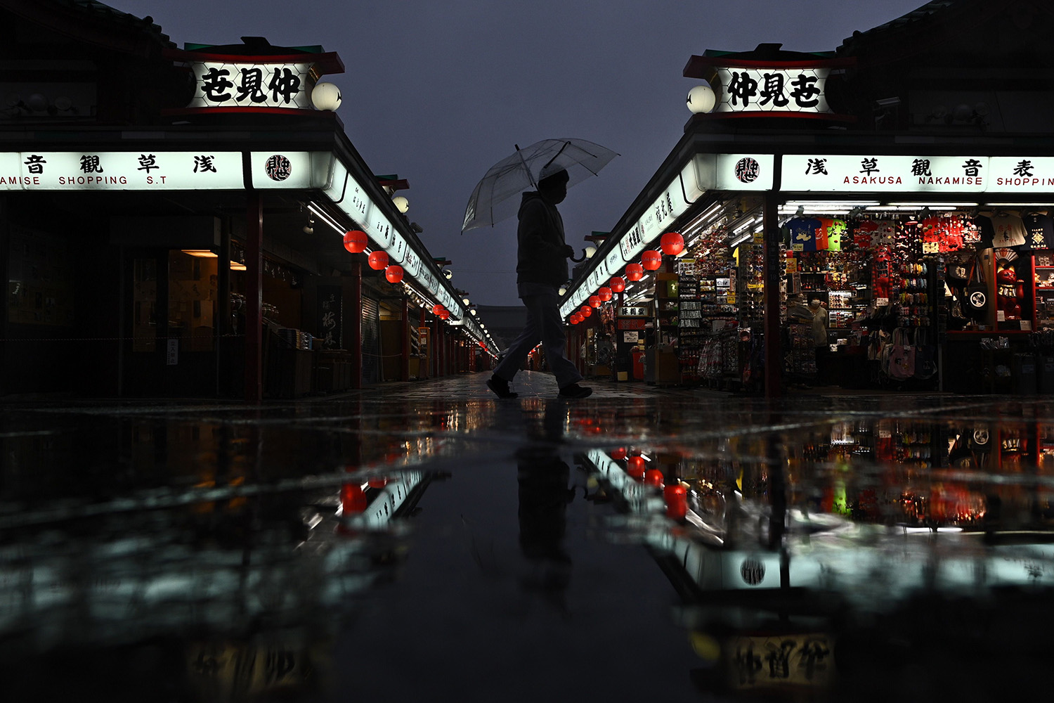 A man walks in the rain at the Sensoji Buddhist temple in Tokyo on April 1. PHILIP FONG/AFP via Getty Images