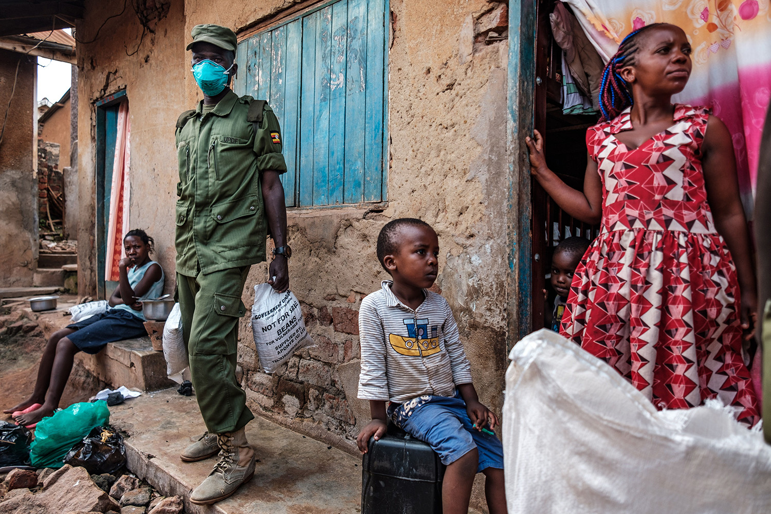 Members of the Local Defense Unit paramilitary force in Kampala, Uganda, deliver flour and beans April 4, the first day of food distribution for people who have been affected by the coronavirus lockdown. SUMY SADURNI/AFP via Getty Images