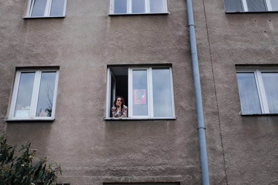 Charlotte Tomaszewska, an opponent of the newest proposed abortion restrictions, poses next to her home protest poster in Warsaw on April 26.