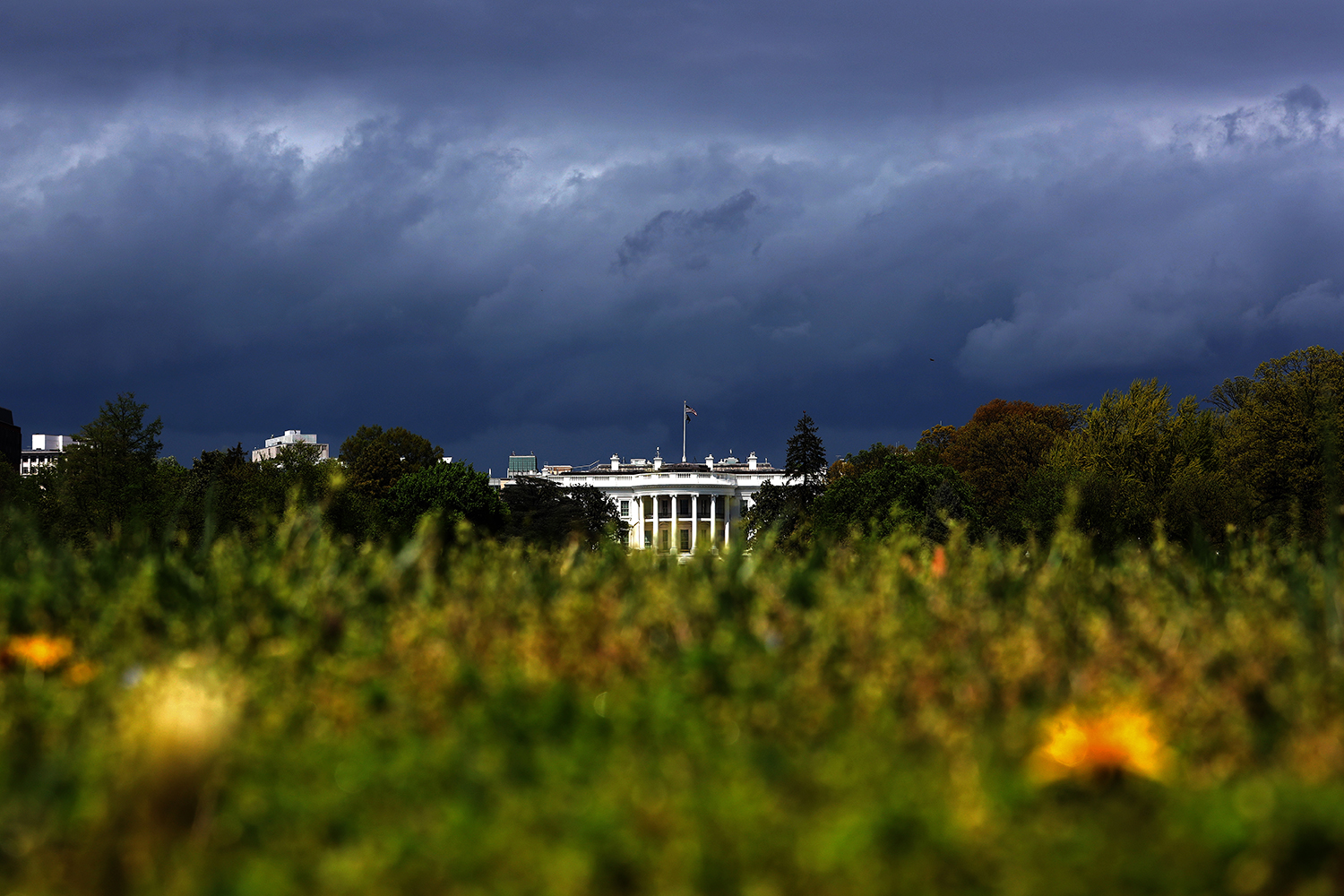 The White House catches a bit of sunlight as storms pass through the Washington, D.C., region April 13. Win McNamee/Getty Images