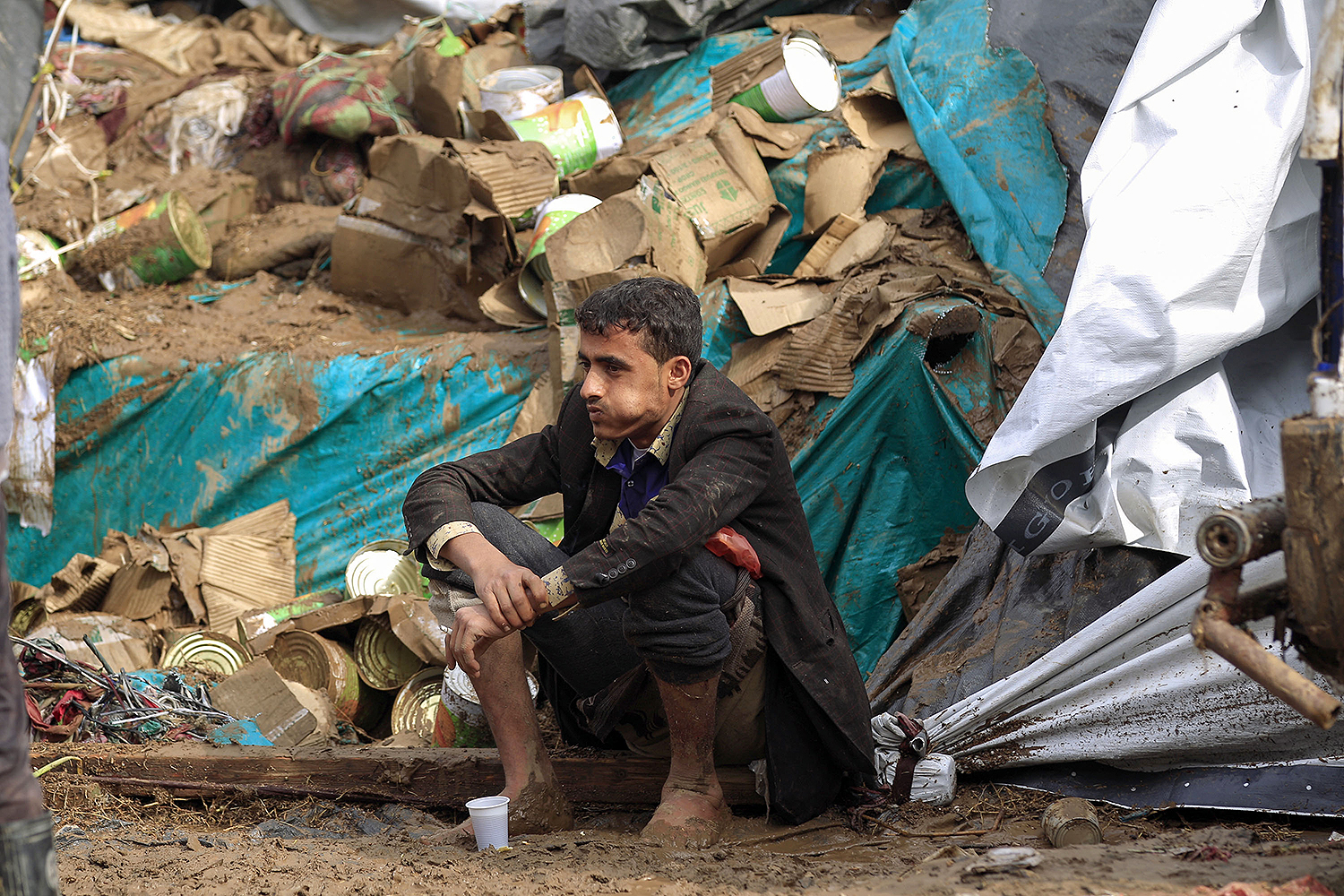 A Yemeni street vendor sits amid the remains of his flood-damaged stall following heavy rains in the capital city of Sanaa on April 14. MOHAMMED HUWAIS/AFP via Getty Images
