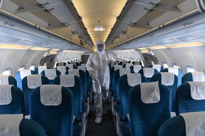 A worker disinfects a Vietnam Airlines plane amid concerns of the spread of the coronavirus at Noi Bai International Airport in Hanoi on March 3.