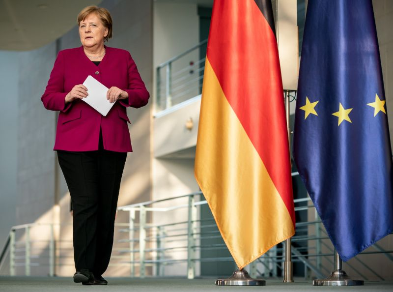 German Chancellor Angela Merkel arrives to address a press conference in Berlin on April 23 after taking part in a video conference with EU leaders.