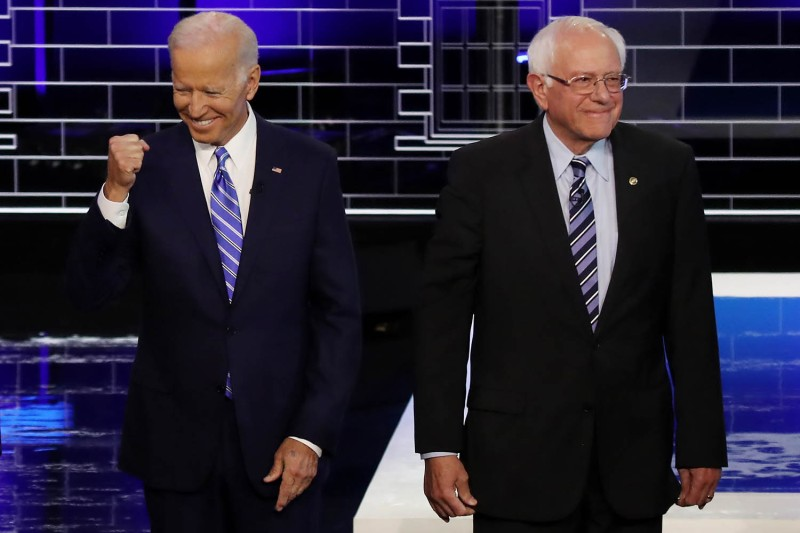 Former Vice President Joe Biden and Sen. Bernie Sanders at the Democratic presidential debate in Miami on June 27, 2019. Drew Angerer/Getty Images