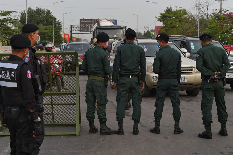 Police block drivers in Cambodia during the coronavirus pandemic