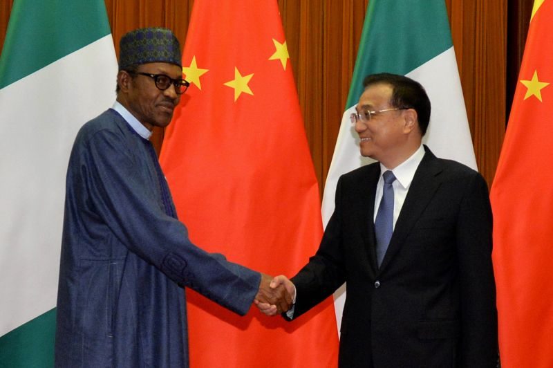 Nigerian President Muhammadu Buhari shakes hands with Chinese Premier Li Keqiang before their meeting in Beijing on April 13, 2016.