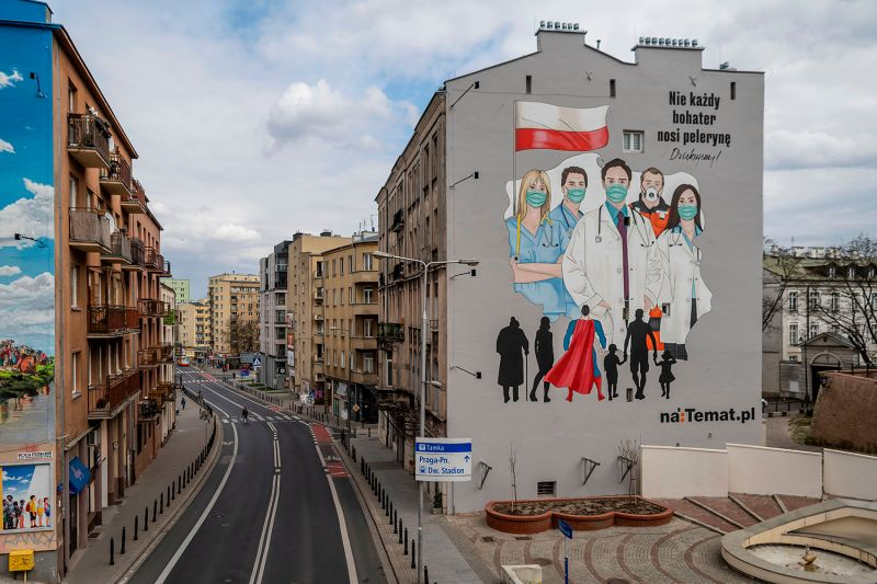 A mural paying tribute to the sacrifice of doctors, nurses, and paramedics fighting the coronavirus pandemic is seen in Warsaw, Poland, on April 2.