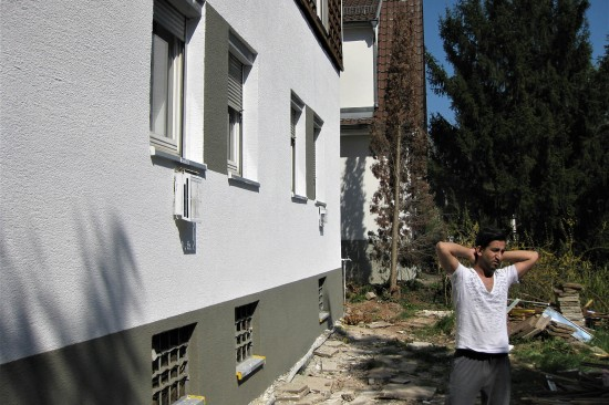 Afghan refugee Abdul Hakim stands in front of his house in Stuttgart, Germany, on April 6.