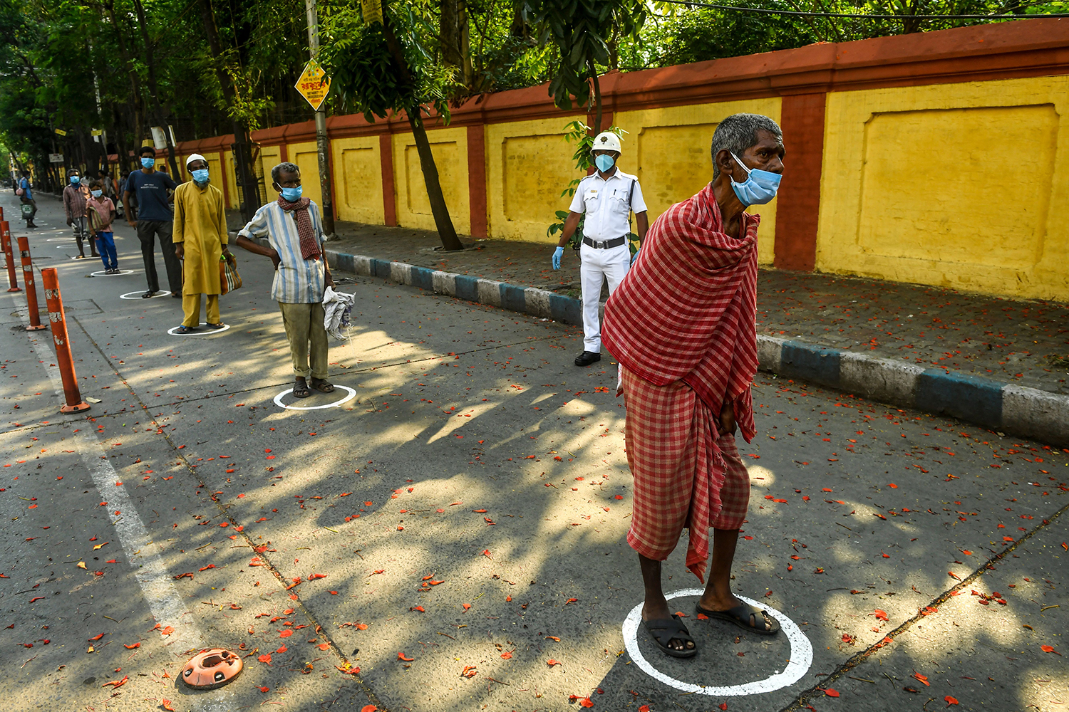 A Coronavirus Mystery: Why Are There So Few Cases in South Asia? photo