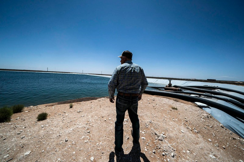 An oil worker surveys pipelines in the Permian Basin in Midland, Texas, on May 4, 2018.