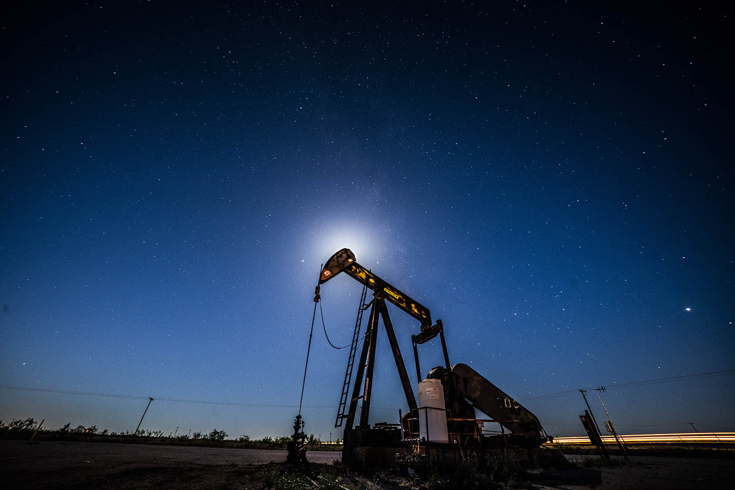 An oil pumpjack is silhouetted against the night sky in Midland, Texas, on May 5, 2018.