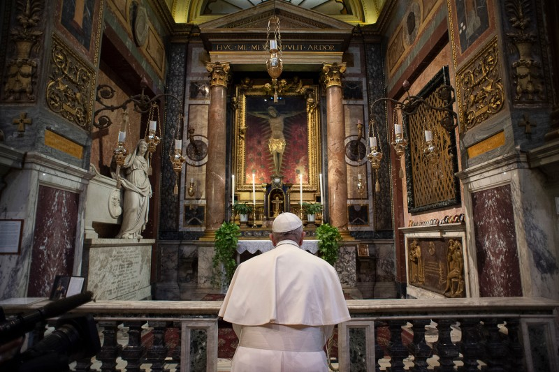 Pope Francis prays in front of a crucifix that in 1552 was carried in a procession around Rome to stop the Great Plague, at the San Marcello al Corso church in Rome on March 15.