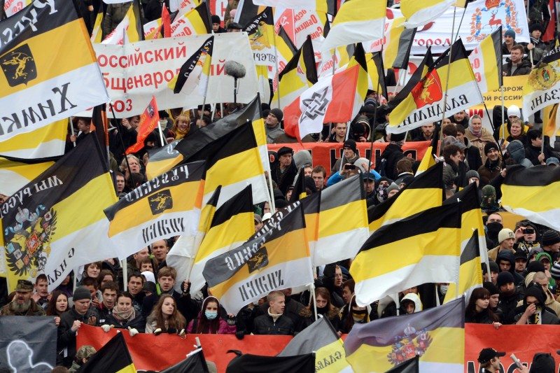 "Russian ultra-nationalists wave Russian Empire's black-yellow-white flags as they take part in the so-called ""Russian March"" in central Moscow on November 4, 2012."