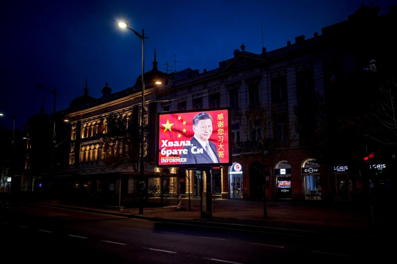 "A picture taken on March 30 in Belgrade shows a billboard bearing Chinese President Xi Jinping's face looking down over a boulevard next to the words ""Thank you brother Xi,"" a message paid for by a pro-government tabloid."