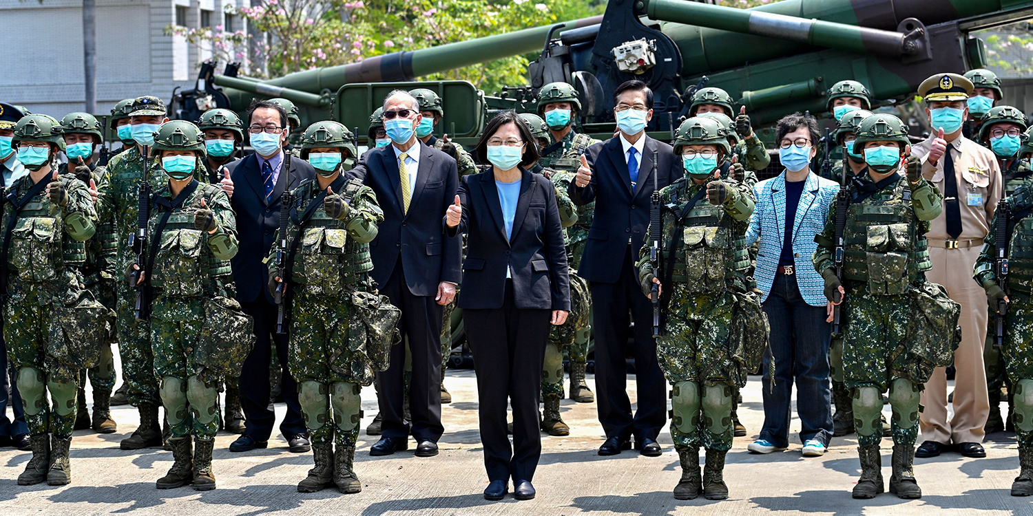 Taiwan President Tsai Ing-wen poses for a photograph with soldiers and other officials, all masked amid the coronavirus pandemic, during her visit to a military base in Tainan, southern Taiwan, on April 9.