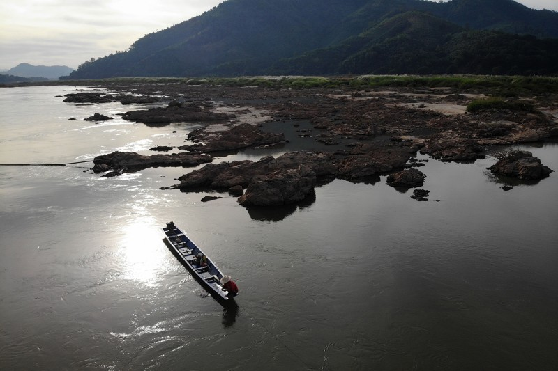 A fisherman floats on the Mekong River in Thailand