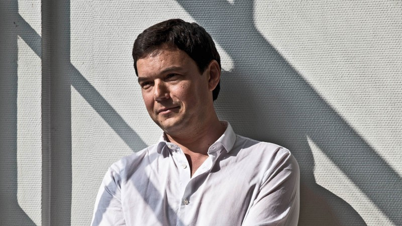 Thomas Piketty is seen at the Paris School of Economics, where he teaches as a professor, May 2, 2014. Piketty, who is also director of studies at l'…cole des Hautes …tudes en Sciences Sociales, is an economist who studies wealth and inequality. He received media attention for his book, Capital in the Twenty-First Century, and for his economic ideas criticizing the focus on austerity in Europe.
