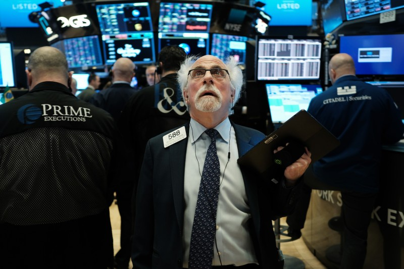 Stock trader Peter Tuchman works on the floor of the New York Stock Exchange.