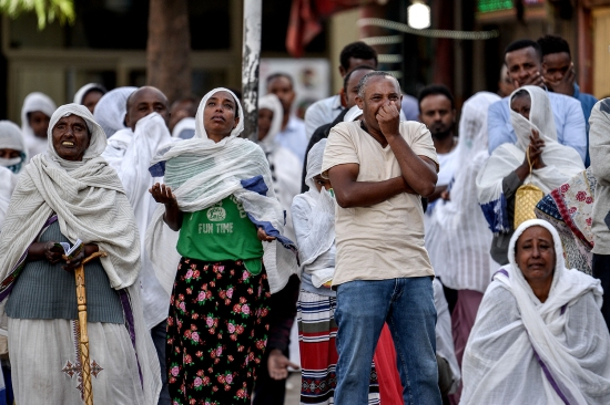 Orthodox Christians pray on the street in Addis Ababa, Ethiopia, on April 5 after police officers blocked their way into the Medhane Alem Cathedral in an effort to stem large gatherings.