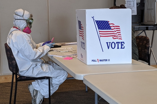 In full hazmat gear, elections chief inspector Mary Magdalen Moser runs a polling location in Kenosha, Wisconsin, for the presidential primary April 7.