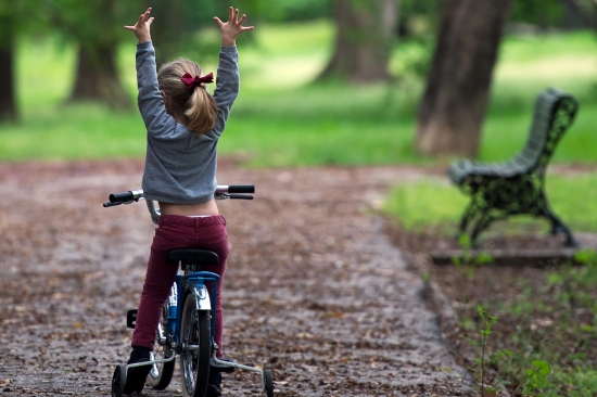 A young girl stretches during a bike ride in a park in Seville, Spain, on April 26. After six weeks stuck at home, Spain's children were allowed out—though the guidance was complicated.