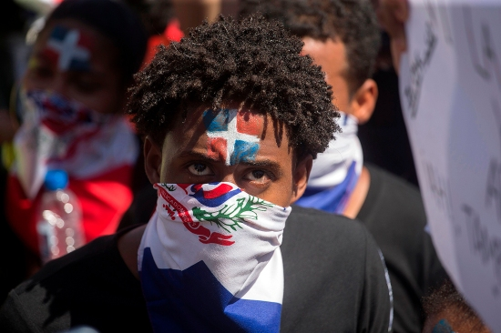 A man takes part in a protest for the suspension of municipal elections in Santo Domingo, Dominican Republic, on Feb. 27.