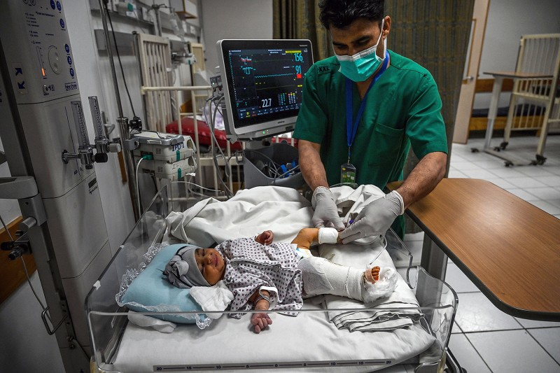 Newborn Bibi Amena receives treatment for a gunshot wound in her leg at the French Medical Institute for Children in Kabul on May 15 after losing her mother during an attack on a maternity hospital earlier in the week. WAKIL KOHSAR/AFP via Getty Images