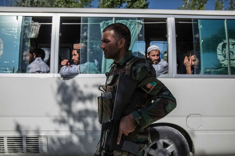 Released Taliban prisoners depart a government prison outside Kabul near Bagram Air Base in Afghanistan on May 26.