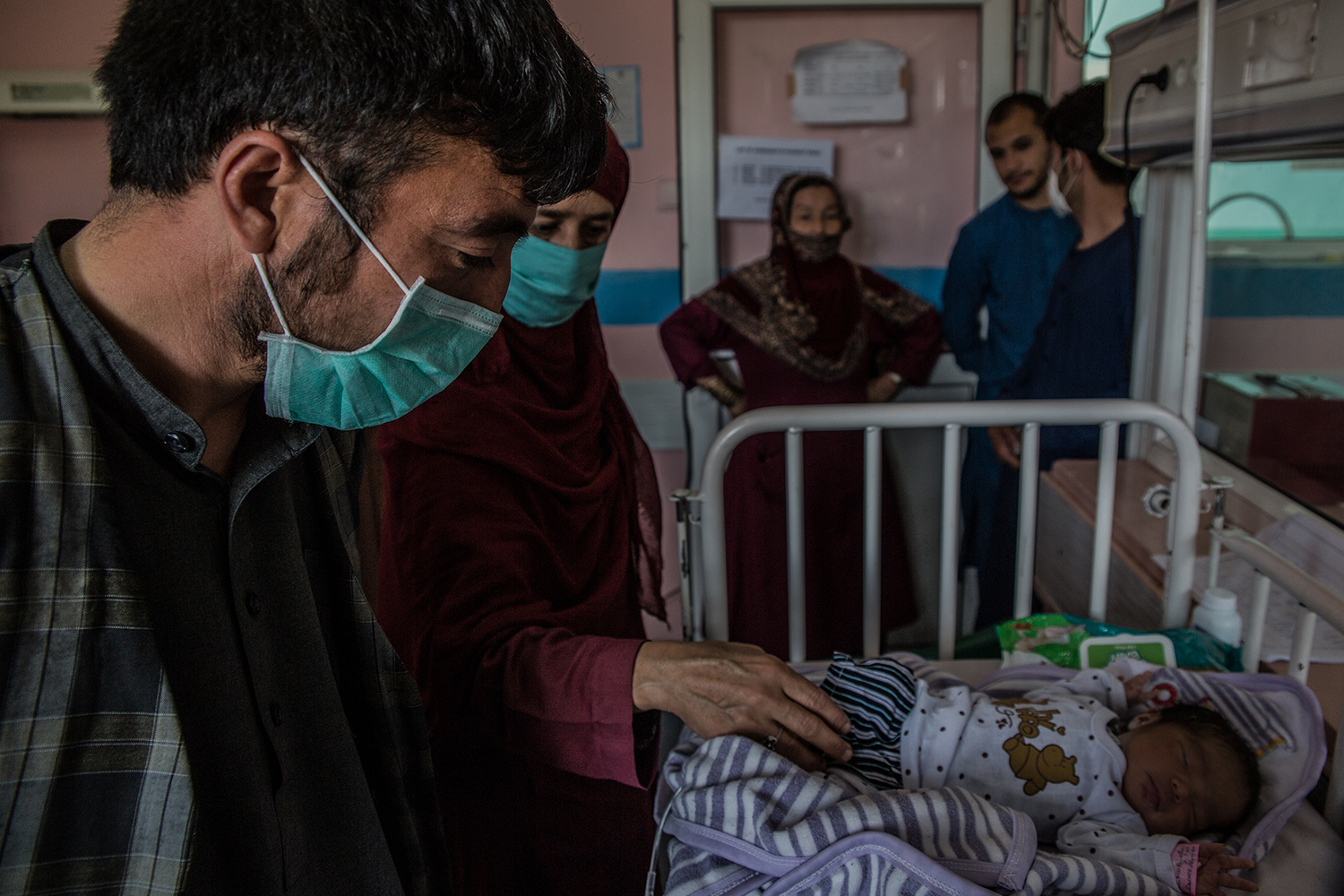 Mohammed Zahir, 30, who lost his wife in the attack after she had given birth to a baby boy, roams Kabul's hospitals on May 13 hoping to find his son who he had not yet met.