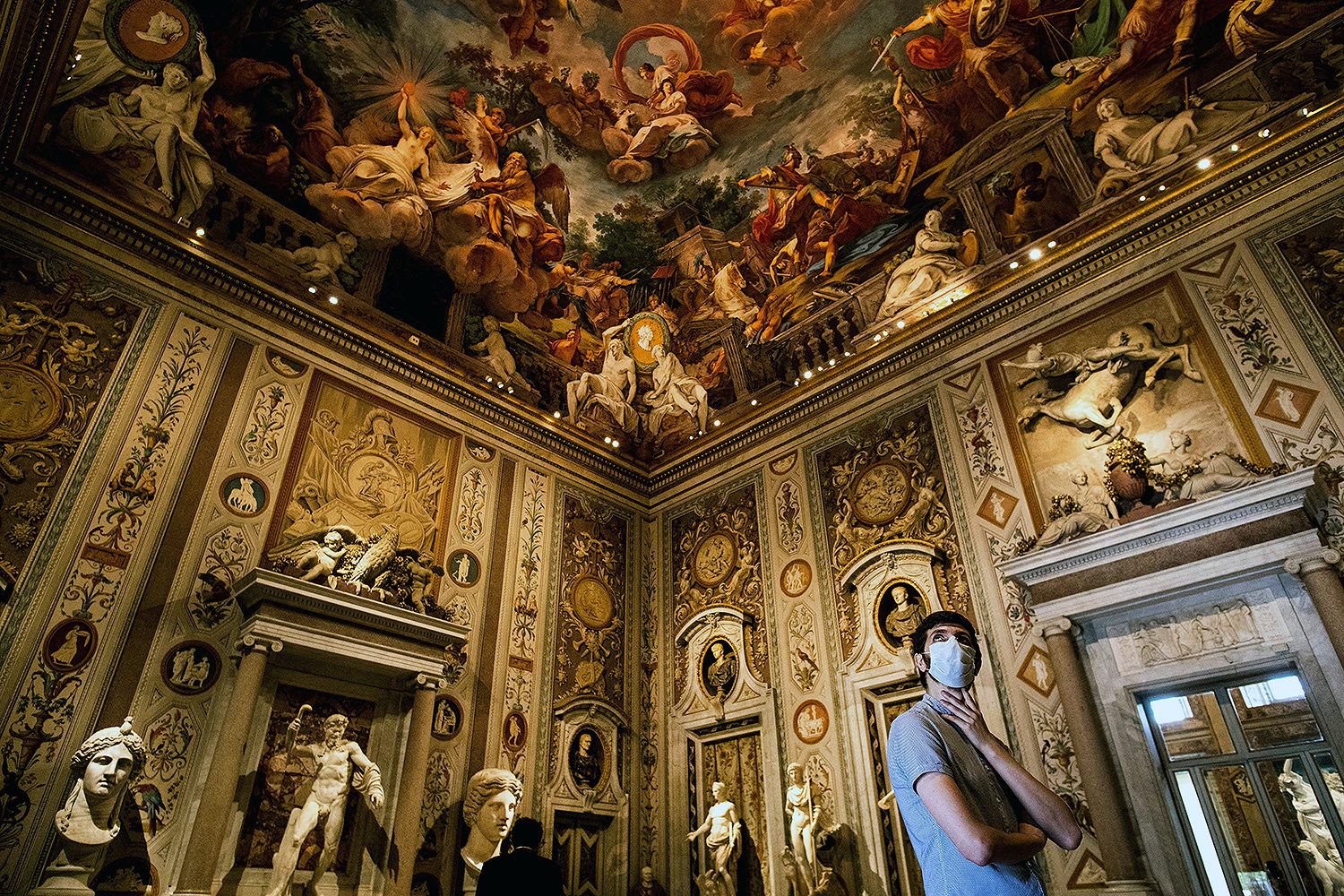 A man visits the newly reopened Galleria Borghese art gallery in Rome on May 19. TIZIANA FABI/AFP via Getty Images