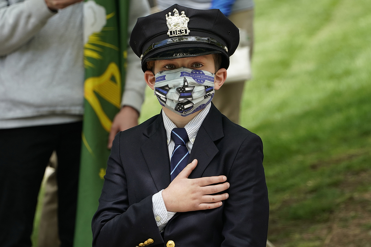 Gavin, 10, looks on during the funeral service of his father, Charles Rob Roberts, a police officer who died of the coronavirus, in Glen Ridge, New Jersey, on May 14. TIMOTHY A. CLARY/AFP via Getty Images
