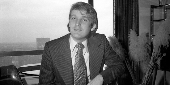 Donald Trump is pictured in his apartment in May 1976 after receiving the news that New York City's Board of Estimate unanimously approved a 40-year tax break for his hotel construction project. Trump was an early beneficiary of the financial disruptions of the 1970s as the tax code shifted.